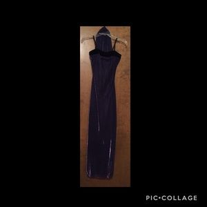 Purple & black dress with sash.